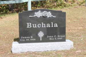 Buchala-Black-Grave-Stone-With-Scalpted-Rose-1024x683