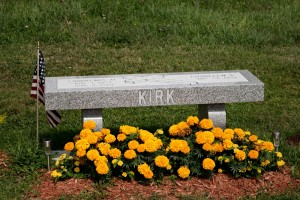 KIRK gray bench with cross grave stone